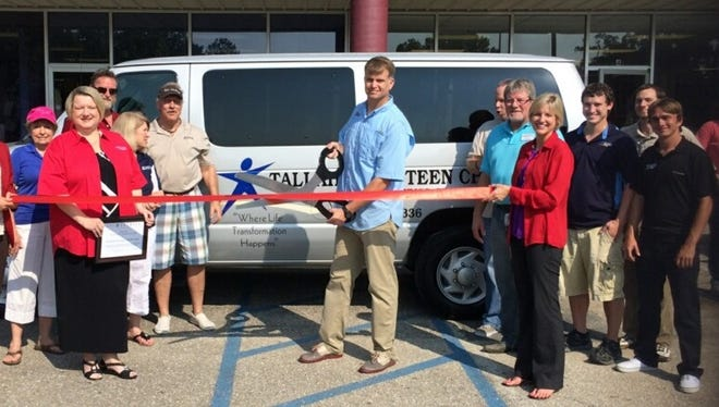 Executive director Travis Moran of Tallahassee Teen Challenge cuts the ribbon Wednesday to officially open the nonprofit's Super Thrift Store at 2645 W. Tennessee St.