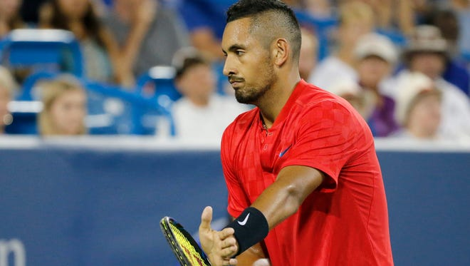 Nick Kyrios claps on his racket after a point in the second set of the match between Nick Kyrgios and Rafael Nadal during the Western & Southern Open at the Lindner Family Tennis Center in Mason, Ohio, on Friday, Aug. 18, 2017. The underdog Kyrgios defeated No. 1-seed Nadal in straight sets, 6-2, 7-5.