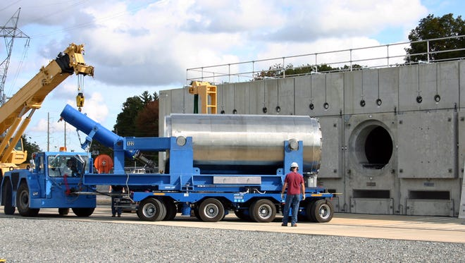 In this Oct. 14, 2010 photo released by Dominion Resources, a trailer holding a spent fuel storage container is maneuvered into position for offloading into a horizontal storage module at the Millstone Power Station in Waterford, Conn. With the collapse of a proposal for nuclear waste storage at Nevada?s Yucca Mountain, Millstone and other plants across the country are building or expanding on-site storage for waste.(AP Photo/Dominion Resources)
