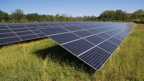 Utility scale solar installation in a field.