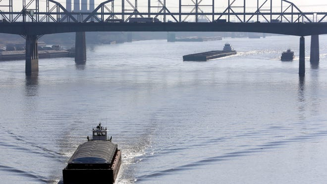 FILE - In this Nov. 16, 2012 file photo, barges power their way up the Mississippi River in St. Louis. Environmental groups have sued the Army Corps of Engineers over the agency's use of man-made structures meant to keep the Mississippi River navigable. The federal lawsuit was filed Thursday, May 22, 2014 in Illinois' East St. Louis. Plaintiffs including the National Wildlife Federation claim the techniques provoke flooding as seen during historic inundations four times in the past two decades. (AP Photo/Jeff Roberson, File)