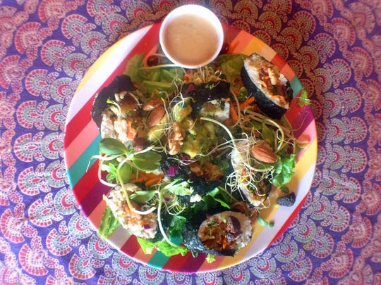 Nori Rolls on a salad with raw sesame dressing is a hot dish at Chef Brooke's Natural Cafe in Fort Myers.