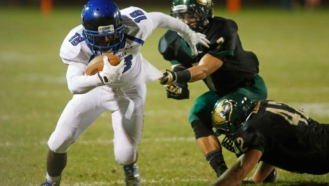 Chandler receiver Terrell Flanigan III breaks free from Bash defenders Brandon Yamamoto (middle) and Zac Archer during a game at Basha High in Chandler on Oct. 24, 2014.