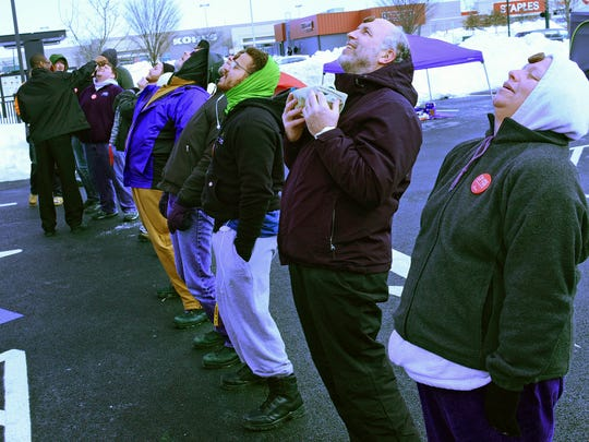 A group plays games in rthe parking lot at Chick-fil-A restaurant on Norland Avenue, Chambersburg, Jan. 27, 2016. The restaurant is giving away sandwich meals to the first 100 people in line as part of a promotion for the store which opens Thursday.