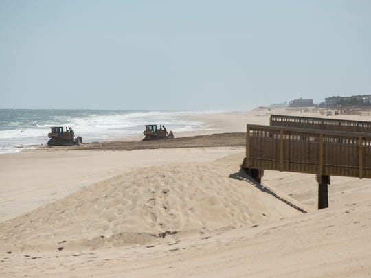 Sand being pushed on to the beach at Bethany Beach.