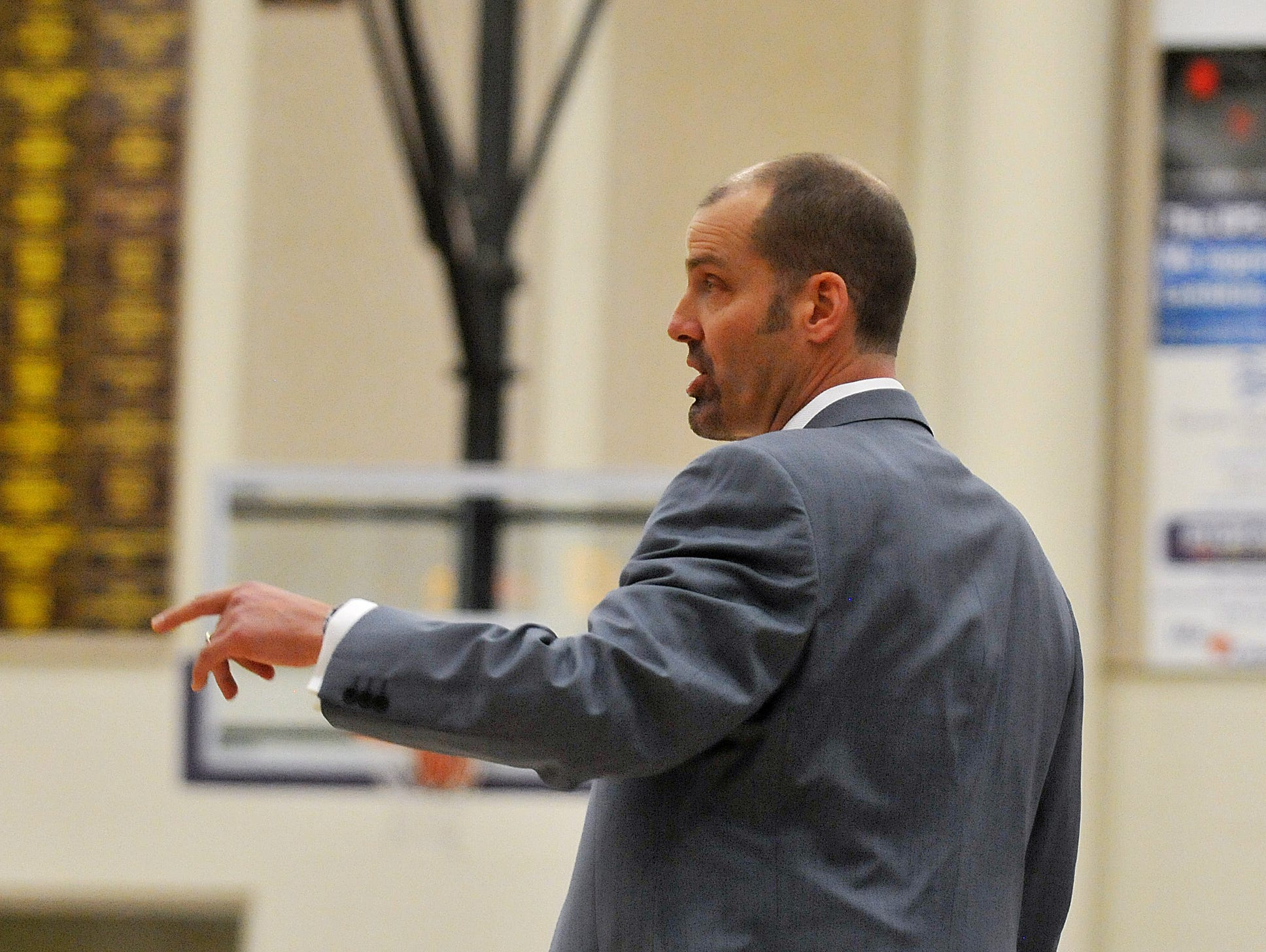 Poudre head coach Steve Hawes motions to a player during their game against Fort Collins, Jan. 11, 2012 at Fort Collins.