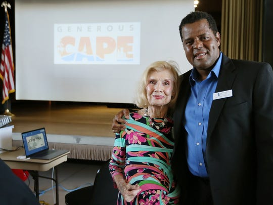 Elmer Tabor Generosity Award winner Michel Doherty is pictured with Michael Chatman, president and CEO of the Cape Coral Community Foundation. The Generous Cape Reception cultivates hometown community pride in Cape Coral and generates a spirit of giving together.