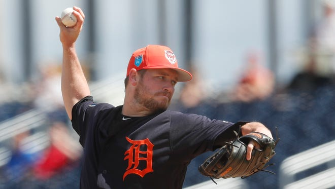 Detroit Tigers pitcher Alex Wilson works against the Washington Nationals in the first inning of a spring training game Sunday, March 4, 2018 in West Palm Beach, Fla.