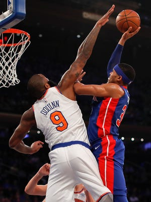 Detroit Pistons forward Tobias Harris (34) puts up a shot against New York Knicks center Kyle O'Quinn (9) during the first quarter of an NBA basketball game, Saturday, Oct. 21, 2017, in New York. (AP Photo/Julie Jacobson)