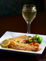 Bella Luna Restaurant and Pizza in Suntree serves Flounder Francese with mixed vegetables.