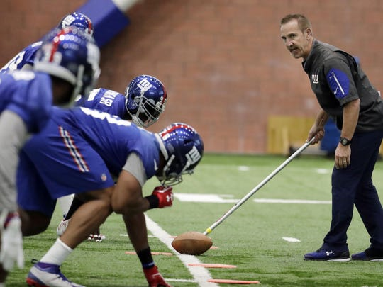 New York Giants defensive coordinator Steve Spagnuolo, right, runs a drill with his players during the team's organized team activities at its training facility in East Rutherford, N.J. When 10 years' worth of labor peace came to the NFL in 2011, so did a massive change in the rules governing practice, during the season, the offseason and, most especially, in training camps.