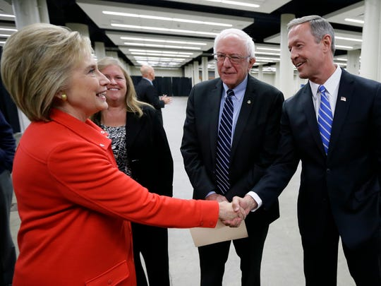 Democratic presidential candidates Hillary Rodham Clinton, left, Sen. Bernie Sanders, I-Vt., and former Maryland Gov. Martin O'Malley, right, talk backstage before the start of the Iowa Democratic Party's Jefferson-Jackson Dinner, Saturday, Oct. 24, 2015, in Des Moines, Iowa.