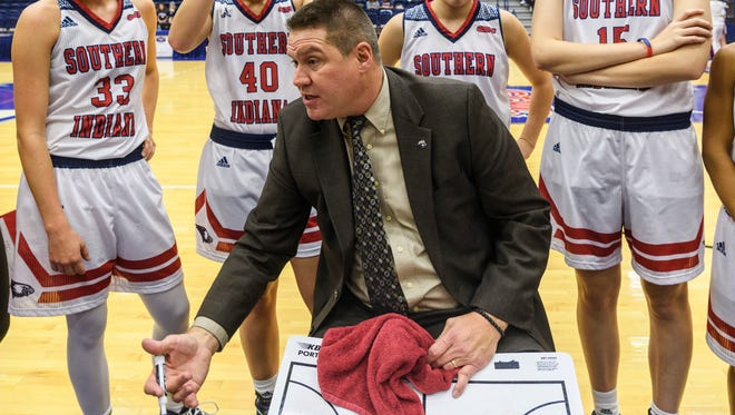 USI Head Coach Rick Stein talks to his team during a timeout in the fourth quarter against the Ohio Dominican Panthers at USI's Physical Activities Center in Evansville, Ind., Thursday, Nov. 16, 2017. The Screaming Eagles defeated the Panthers, 77-50.