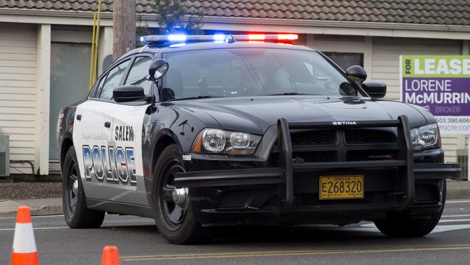 A Salem Police Department vehicle sits near an incident.