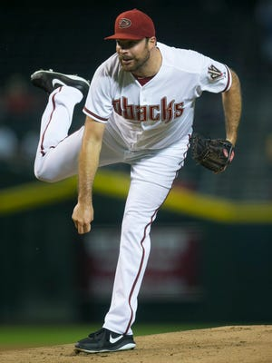 Diamondbacks pitcher Josh Collmenter pitches against the Padres at Chase Field on Aug. 22, 2014.