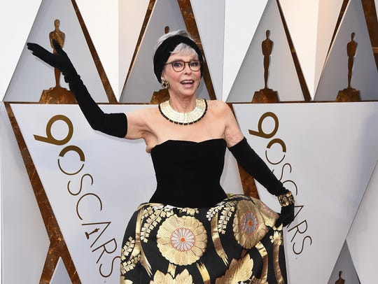 Rita Moreno arrives at the Oscars on Sunday wearing