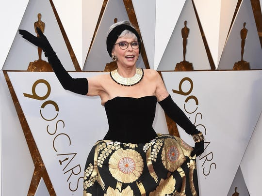 "Rita Moreno arrives at the Oscars on Sunday wearing the same dress she wore in 1962 when she won an Oscar for ""West Side Story."""