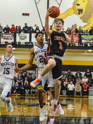 Central York's Cade Pribula leaps to the hoop on a