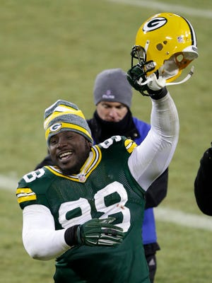 Green Bay Packers nose tackle Letroy Guion celebrates the victory against Detroit.