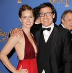 Amy Adams and director David O. Russell pose at the Golden Globe Awards.