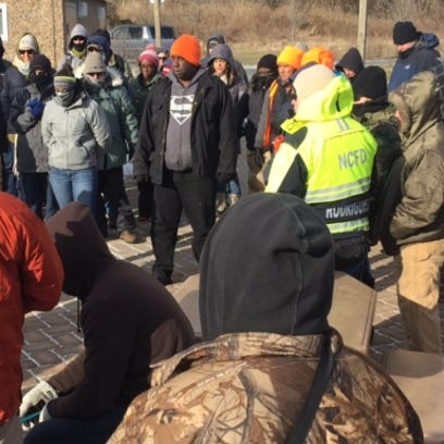 Volunteers gather in St. Georges on Saturday to search