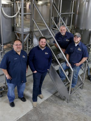 Greg Rouse, Jake Rouse, Richard Dube' and Evan Rouse of Braxton Brewing Company in their newly remodeled space on West Seventh Street in Covington.