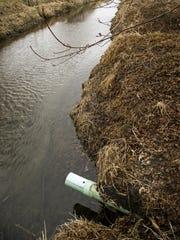 A farm field tile drain in rural Iowa.