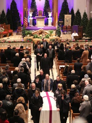 With a windchill approaching zero degrees, scores of mourners braved the cold Friday morning to attend the funeral of former mayor and community fixture Gloria Kolodziej.