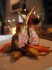 Herb crusted lambed over baby carrots and potatoes