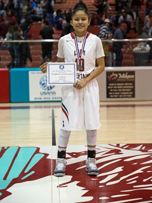 Shiprock's Melanie Secody poses for a photo after being named first team All-District on Feb. 25 at the Chieftain Pit in Shiprock.