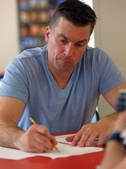 Ken Dronzek takes notes during a training session for