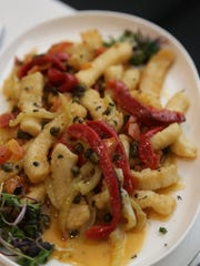 Calamari with beurre blanc, capers and peppers from