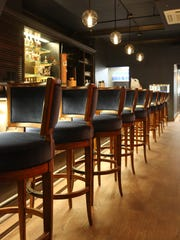 The bar area of the Caucus Club has a more modern vibe
