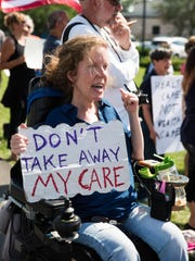 Megan Anderson protests at Bryant's Rent-All in Lexington, KY, where Vice President Mike Pence spoke about the need to repeal and replace Obamacare. July 12, 2017.
