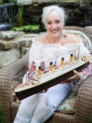 University of Tennessee associate professor Shelley Binder holds a replica of the Titanic that her husband gave to her as a gift, prompting her renewed interest in her family history and its connection to the Titanic.