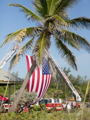 Martin County Fire Rescue displays a U.S. flag during