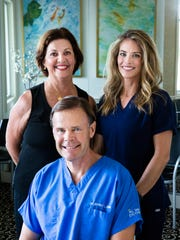 Barb Murtagh, a certified registered nurse anesthetist, from left, Dr. Jeffrey Zimm, an ophthalmologist, and Dr. Lynn Byerly, an ophthalmologist, made a trip to Jamaica in April.