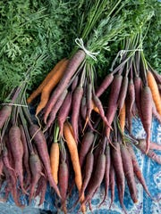 Organic purple carrots are pictured at the Drake Farmers