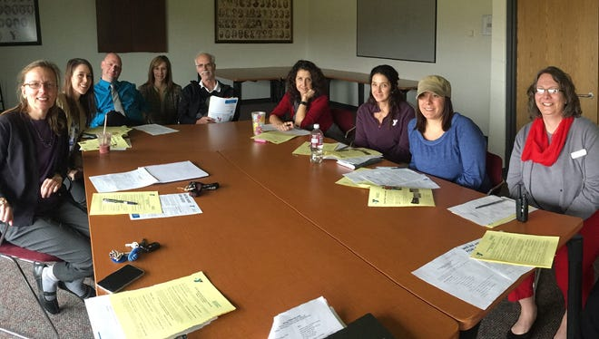 Y staff and volunteers working together on public relations for a fundraising campaign. From left, areTheresa Lubke, Nissa Stump, Kurt Moore, Nicole Workman, Jeff Ruth, Carrie Guyton, Heather Wright, Leslie Schneider, Cindy Rosa and Janice Moodley.