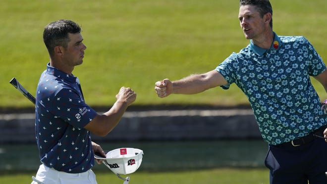 Gary Woodland, left, and Justin Rose, of England, nearly touch fists on the 18th green following the third round of the Charles Schwab Challenge golf tournament at the Colonial Country Club in Fort Worth, Texas, Saturday, June 13, 2020.