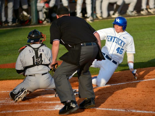 Kentucky's Thomas Bernal is tagged out at home plate by Louisville's Kyle Gibson in the bottom of the fifth inning. (April 1, 2014)