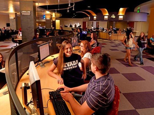 @One (with technology): Students collaborate and innovate in @One, located on the first floor of the Mathewson-IGT Knowledge Center.