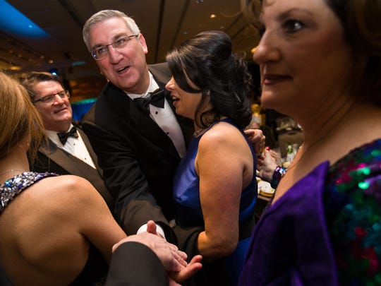 Indiana Gov. Eric Holcomb and his wife, Janet, (center)