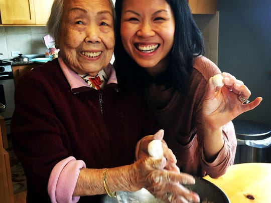 Benita Cooper cooks with her 96-year-old grandmother, Mei Chiu. The older woman's stories inspired Cooper to start a storytelling group for seniors.
