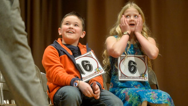 Lincoln Elementary School sixth-grader Ali Naber, right, remains in shock moments after winning the 2018 Cascade County Spelling Bee on Friday at West Elementary School.  Naber was able to correctly spell the word 'zinnia' to secure first place over Lewis and Clark Elementary School fourth-grader Carson Bautista, left.