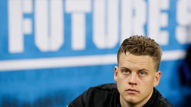 LSU quarterback Joe Burrow watches a drill at the NFL football scouting combine in Indianapolis, Thursday, Feb. 27, 2020. (AP Photo/Charlie Neibergall)