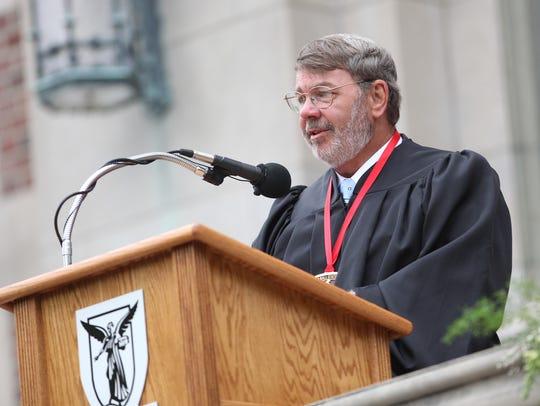 Real estate developer John Scheumann gives a speech