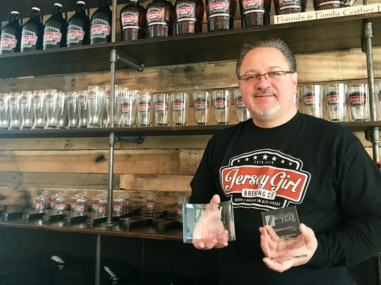 Jersey Girl Brewing co-owner Charles Aaron holds an