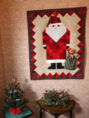 Margaret Smith made this Santa quilt in 2003 and hangs it every year in the entry hall.