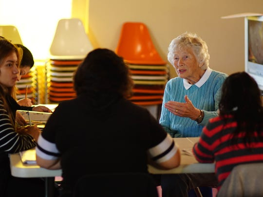 Janet Saunders, a volunteer for Literacy Delaware leads a group of mothers in an English language class.